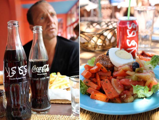 grilled meats and vegetables at a rooftop lunch in Marrakech + Coke bottles with Arabic calligraphy